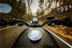 The view over the handlebars of motorcycle Royalty Free Stock Photo
