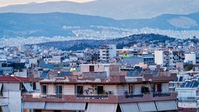 View Over High Density Suburban Houses to Saronic Gulf, Athens, Greece. Detail of suburban Athens high density concrete slab and pillar multi level houses stock photos