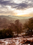 View over the hills on a frosty day, with snow Stock Images
