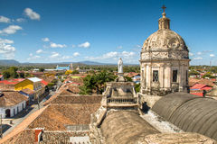 View over the historical centre of Granada, Nicaragua. View of the historical centre of Granada, Nicaragua with several cathedrals, churches and the lake in the Royalty Free Stock Images