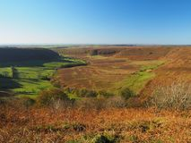 Hole of Horcum with view across the moors. View over the Hole of Horcum with blue sky in North York Moors National Park, Yorkshire, UK Royalty Free Stock Images