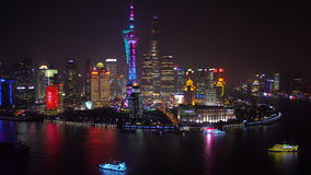 View over Huangpu River & Pudong skyline at night, Shanghai stock footage