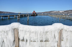 View over ice curtain down Seneca Lake. Showing the Seneca Lake dock after winter storm Stella. One of the Finger Lakes of New York State. At 38 miles long and stock images