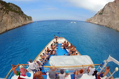 Summer landscape. Ionian Sea from the Navagio Bay - Zakynthos Island, landmark attraction in Greece. Seascape. Tourists on a cruise ship moving away from the stock images