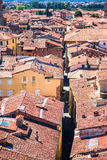 View over italian town Lucca with typical terra-cotta roofs. Aerial view of ancient building with red roofs in Lucca Royalty Free Stock Image