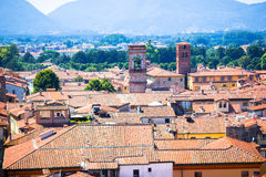 View over italian town Lucca with typical terra-cotta roofs. Aerial view of ancient building with red roofs in Lucca Royalty Free Stock Photos