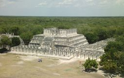 View over jungle Chichen Itza. View from the top of the pyramid at Chichen Itza looking over the Yucatan Peninsula Stock Photo