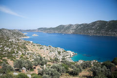 View over Kalekoy Simena bay in Uchagiz village. View of Kalekoy Simena bay in Uchagiz village of Antalya province of Turkey with lycian tombs on left and some Stock Images