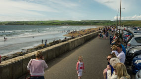 View over Lahinch boulevard with many tourists enjoying a beauti Royalty Free Stock Photography