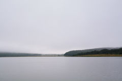 View over lake on a gloomy day Stock Photo