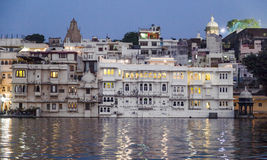 View over lake Pichola at dusk to city of Udaipur Stock Photography
