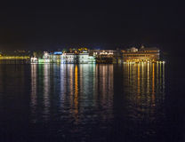 View over lake Pichola at dusk to thew Lake palace Royalty Free Stock Image