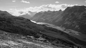 View over Lake Sils in the background (Engadin, Switzerland) and Lake Silvaplana (foreground). Lake Sils (German Silsersee, Romansh: Lej da Segl) is a lake in Royalty Free Stock Images