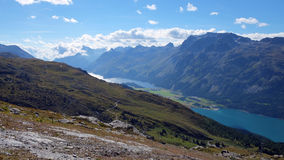 View over Lake Sils in the background (Engadin, Switzerland) and Lake Silvaplana (foreground). Lake Sils (German Silsersee, Romansh: Lej da Segl) is a lake in Royalty Free Stock Photos