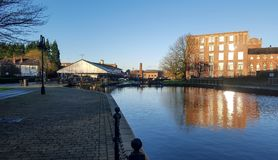 Wigan Dry Dock on the Leeds Liverpool canal. The view over the Leeds Liverpool canal to the dry dock in Wigan Royalty Free Stock Photography