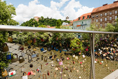View over love lockers to the old clock tower on Schlossberg, castle hill, in Graz, Austria Royalty Free Stock Image