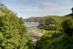 View over Lynmouth, Exmoor, North Devon. View over Lynmouth towards Foreland Point and wooded valley of Watersmeet, Exmoor, North Devon Stock Photo