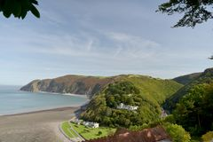 View over Lynmouth, Exmoor, North Devon. View over Lynmouth towards Foreland Point and wooded valley of Watersmeet, Exmoor, North Devon Royalty Free Stock Images