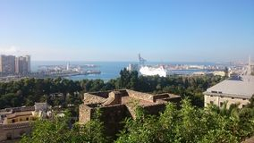 View over Malaga with trees, the sea and a ship stock photos