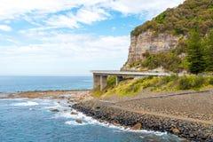 View over the 665 metre long Sea Cliff Bridge, a balanced cantilever bridge along the scenic Grand Pacific Drive in Coalcliff, NSW Stock Photos