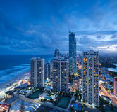 View over the modern city at dusk. With ocean beside on square format (gold coast,queensland,australia Stock Photos