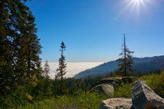 View over the mountain landscape and over the clouds. Moro Rock, Sequoia National Park, California, USA stock photography