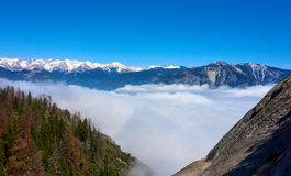 View over the mountain landscape and over the clouds. Moro Rock, Sequoia National Park, California, USA stock images