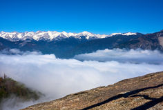 View over the mountain landscape and over the clouds with rocks in the foreground. Moro Rock, Sequoia National Park, California, USA royalty free stock images