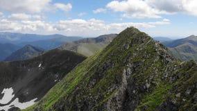 Passing over the Vistea Mare and Moldoveanu peaks - Fagaras Mountains Romania stock footage