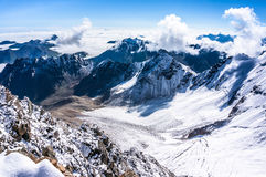 view from the birds-eye  over the mountains and clouds Royalty Free Stock Images