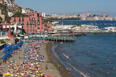View over one of the beautiful beaches with houses touching the coastline - Naples stock image