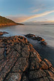 View over Pacific ocean. Sunrise over rocks along the pacific ocean Royalty Free Stock Image