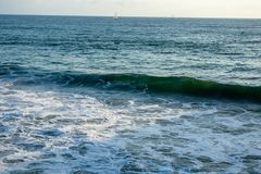 Pacific Ocean Waves and Boats royalty free stock photography