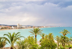 View over the palm trees and coastline of Peniscola, Spain Stock Photos