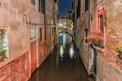 View over a picturesque canal at night, Venice, Italy Royalty Free Stock Photo