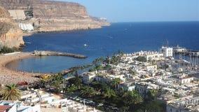 The port and beach at Puerto de Mogan, Gran Canaria. View over the picturesque port and beach at Puerto de Mogan, Gran Canaria, Canary Islands royalty free stock photos