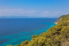 A view over the pine forest on the turquoise sea royalty free stock photos