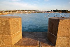 View over the ramparts of the walled city of Saint Malo at sunset, with the harbor and Saint Servan in the background, Saint Malo royalty free stock photo