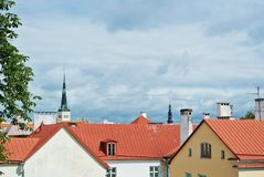 A view over red tile roofs of white and yellow houses of Tallin Royalty Free Stock Photography