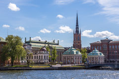 View over Riddarholmen. A Scenic View over Riddarholmen Sweden including a Church with a Blue Cloudy Sky Stock Image