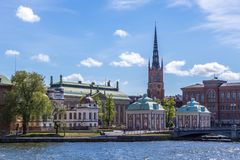 View over Riddarholmen. A Scenic View over Riddarholmen Sweden including a Church with a Blue Cloudy Sky Royalty Free Stock Photo