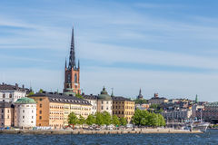 View over Riddarholmen. A Scenic View over Riddarholmen Sweden including a Church with a Blue Cloudy Sky Royalty Free Stock Images
