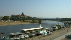 River Elbe and Saxon State Chamber. View over the river Elbe with tourist boats and the Saxon State Chamber palace on a hot summer day stock footage