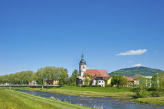 View over the river Murg on the parish church Saint Laurentius Stock Photography