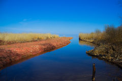 View over the river outfall, coastline and blue sea. And sky Stock Images