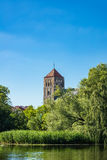 View over the river Warnow to a church in Rostock Stock Images