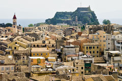 View over roof tops of Corfu town. View of roof tops and Old Fortress in Corfu town Stock Photo