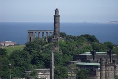 Edinburgh`s Folly and Nelson Monument stock photo