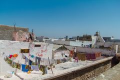View over the roofs of houses with different clothes  after washing in the old arabic town of Essaouira. Morocco, Africa Stock Photo