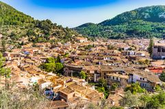 Esporles, small town in beautiful mountain landscape on Majorca, Spain. View over the roofs of the mediterranean village Esporles on Majorca island, Spain stock photos